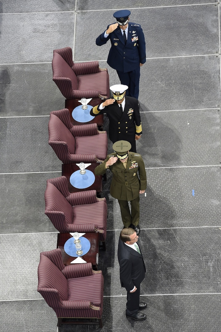 From top to bottom, Gen. John E. Hyten, U.S. Strategic Command (USSTRATCOM) commander; Adm. Cecil D. Haney, former USSTRATCOM commander; and Gen. Joseph Dunford, Chairman of the Joint Chiefs of Staff, salute Secretary of Defense Ash Carter at USSTRATCOM's change of command ceremony at Offutt Air Force Base, Neb., Nov. 3, 2016. Carter presided over the change of command and provided remarks during which he thanked Adm. Cecil D. Haney, outgoing USSTRATCOM commander, for his service. He also congratulated Gen. John E. Hyten on his appointment as the new USSTRATCOM commander. Additionally, Chairman of the Joint Chiefs of Staff Gen. Joseph F. Dunford provided remarks during the ceremony and presented the Joint Meritorious Unit Award to USSTRATCOM. Hyten previously served as commander of Air Force Space Command, and Haney will retire from active military duty during a separate ceremony in January. One of nine DoD unified combatant commands, USSTRATCOM has global strategic missions assigned through the Unified Command Plan that include strategic deterrence; space operations; cyberspace operations; joint electronic warfare; global strike; missile defense; intelligence, surveillance and reconnaissance; combating weapons of mass destruction; and analysis and targeting. (U.S. Navy photo by Petty Officer 1st Class Byron C. Linder)
