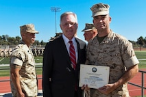 161019-N-AC887-003 Col. William Pitman accepts an award from Secretary of the Navy Ray Mabus on behalf of Marine Corps Recruit Depot San Diego at Marine Corps Base Camp Pendleton, Calif., Oct. 19, 2016. The Secretary of the Navy Energy and Water Management Awards recognize those Marines, Sailors and civilian employees whose ingenuity and dedication led the way to achieving energy goals and helped change the way the Services think about and use power. (U.S. Navy photo by Chief Petty Officer Sam Shavers)