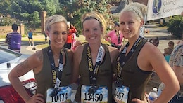 Marine veterans Jaclyn Halsey, Kasey Miller and Molly Zimmer pose for a photo after completing the 41st Marine Corps Marathon on Oct. 30, 2016 in Arlington, Va. The three girls went to boot camp together in 2009 and finished their service in 2012.  They have been training virtually together over the past year to prepare for the marathon, where they met for the first time since 2012.
