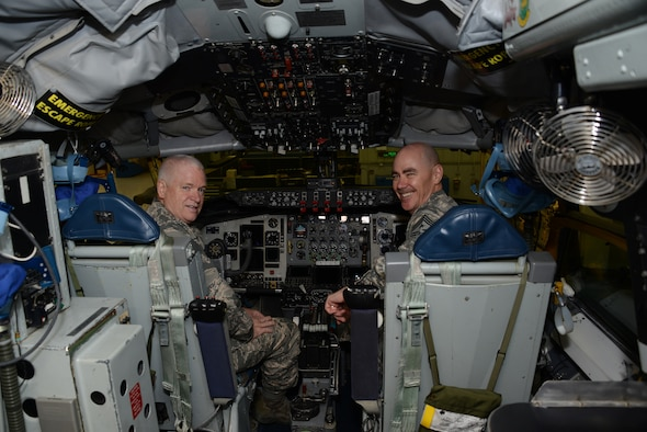 Air National Guard Director, Lt. Gen. Scott Rice is in the pilot seat while Chief Master Sgt. Ron Anderson, Air National Guard Command Chief sits in the copilot seat of a KC-135 assigned to the 185th Air Refueling Wing, during a tour in Sioux City, Iowa on November 5, 2016. 