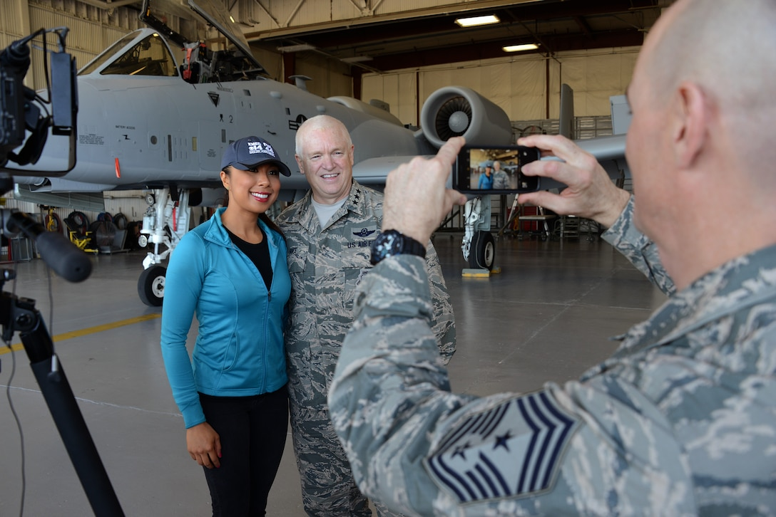 Air National Guard Director, Lt. Gen. Scott Rice and Ms. Jetske Wauran Journalist with KMEG TV pose, while Chief Master Sgt. Ron Anderson, Air National Guard Command Chief photographs them in front of a freshly painted U.S. Air Force A-10 Thunderbolt at the Air National Guard Paint Facility in Sioux City, Iowa on November 5, 2016.  U.S. Air National Guard photo by Master Sgt. Vincent De Groot 185 ARW PA
