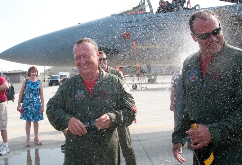 Lt. Col. Joe Monk Keenan, 104th Fighter Wing flight surgeon, and Lt. Col. Ken Hatman Fedora, 104th Fighter Wing F-15 pilot, celebrate the end of their military careers on Sept. 10, 2016, at Barnes Air National Guard Base, Westfield, Mass. (U.S. Air National Guard photo by 1st Lt. Bonnie Harper/released)