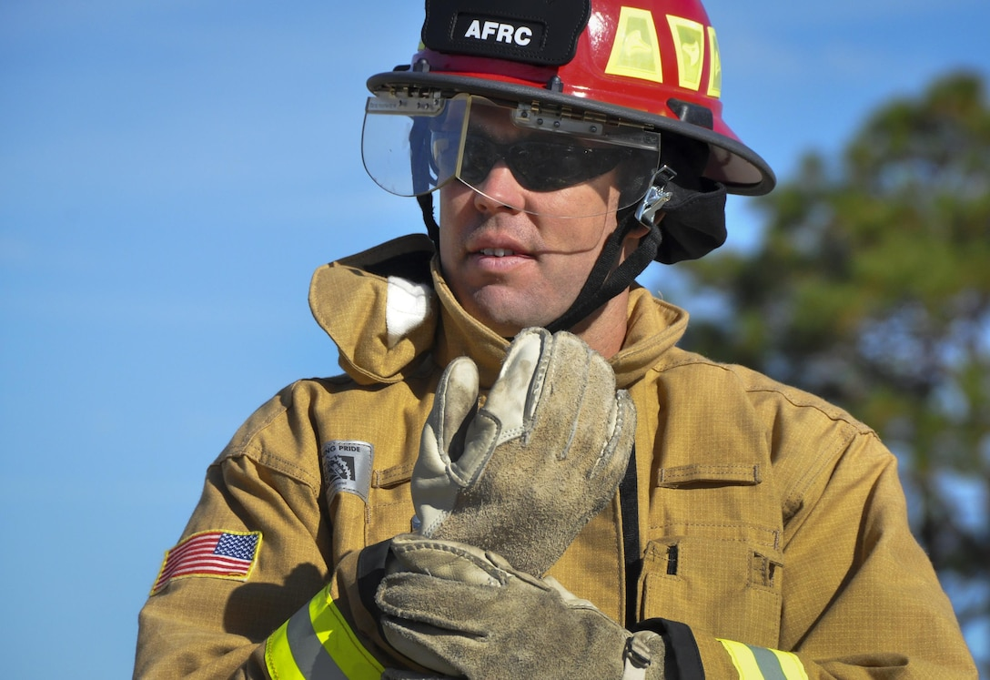 Tech. Sgt. Jeremy Anderson, a 919th Special Operations Wing firefighter, prepares for a car extraction training exercise at Duke Field, Fla., Nov. 6. The wing's firefighters took part in the exercise to meet their bi-annual training requirement.  (U.S. Air Force photo/Dan Neely)