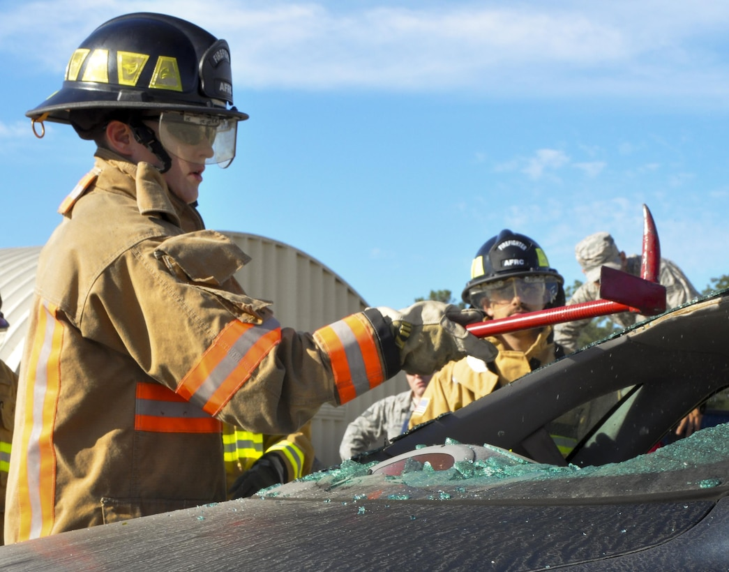 A 919th Special Operations Wing firefighter clears glass from the back window during a car extraction training exercise at Duke Field, Fla., Nov. 6. The wing's firefighters took part in the exercise to meet their bi-annual training requirement.  (U.S. Air Force photo/Dan Neely)
