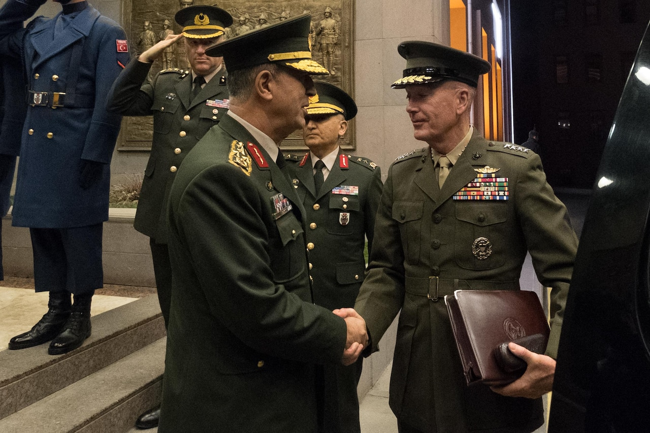 Army Gen. Hulusi Akar, the chief of the Turkish General Staff, bids farewell to Marine Corps Gen. Joe Dunford, chairman of the Joint Chiefs of Staff, right, following meetings in Ankara, Turkey, Nov. 6, 2016. DoD Photo by D. Myles Cullen