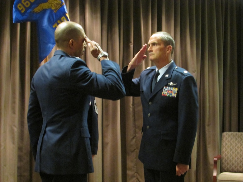 Col. Anthony M. Perkins, 960th Cyberspace Operations Group commander, and Maj. Karl Miller, 710th Network Operations Squadron commander, exchange salutes during an activation ceremony at Robins Air Force Base, Ga., Nov. 6. Miller assumed command of the unit, as its first commander. (U.S. Air Force photo by 2nd. Lt. Michael Wisniewski)