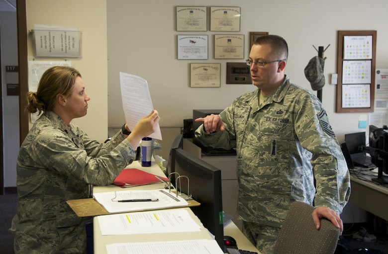 Senior Master Sgt. John Besselman, 446th Force Support Squadron chief of force development, discusses education benefits with Lt. Col. Jennifer Hrivnak, 446th Aeromedical Squadron, May 1, 2016 in the education and training office. The 446th FSS Education and Training Office was awarded the Nathan Altschuler Outstanding Education and Training Program of the Year April 16, 2016 by Air Force Reserve Command. Besselman was named the Force Support Noncommissioned Officer of the Year for AFRC. (U.S. Air Force photo by Tech. Sgt. Bryan Hull)