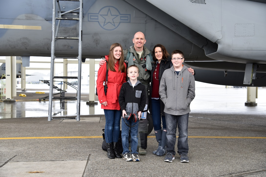 Oregon Air National Guard Col. Paul T. Fitzgerald, 142nd Fighter Wing Commander pauses for a photograph with his family after his Fini Flight in the F-15 Eagle, Nov. 5, 2016, Portland Air National Guard Base, Ore. (U.S. Air National Guard photo by Senior Master Sgt. Shelly Davison, 142nd Fighter Wing Public Affairs)