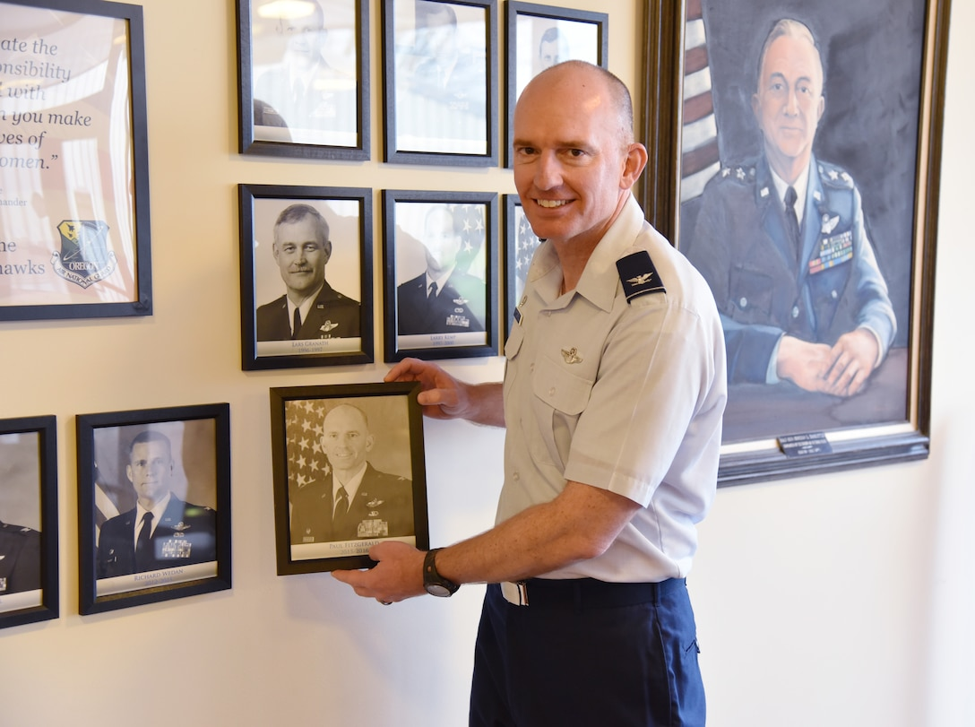 U.S. Air Force Col. Paul T. Fitzgerald, 142nd Fighter Wing commander hangs his photograph on the wall of retired wing commanders prior to his official retirement, Nov. 6, 2016, Portland Air National Guard Base, Ore. (U.S. Air National Guard photo by Senior Master Sgt. John Hughel, 142nd Fighter Wing Public Affairs).