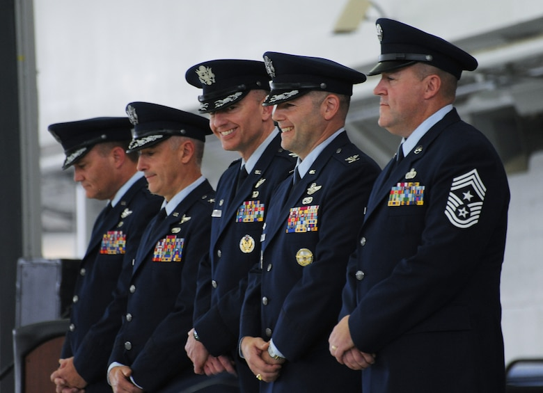 Members of the Oregon Air National Guard Change of Command Party enjoy a lighter moment during the ceremony as Col. Paul T. Fitzgerald, (center) hands the command to Col. Duke A. Pirak, (fourth from left), Portland Air National Guard Base, Ore., Nov. 6, 2016. (U.S. Air National Guard photo by Tech. Sgt. John Hughel, 142nd Fighter Wing Public Affairs).