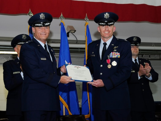 U.S. Air Force Brig. Gen. Michael E. Stencel, The Adjutant General of Oregon, left, presents The Legion of Merit certificate to Col. Paul T. Fitzgerald, the outgoing 142nd Fighter Wing commander, right, during the 142nd Fighter Wing change of command ceremony, Portland Air National Guard Base, Ore., Nov. 6, 2016. (U.S. Air National Guard photo by Tech. Sgt. John Hughel, 142nd Fighter Wing Public Affairs)