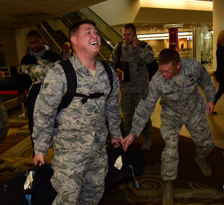 Senior Airman Tyler Meeks, a member of the 118th Security Forces Squadron, collects his bags upon returning from deployment Nov. 6, 2016 in Nashville, Tennessee. Many members of the 118th SF deployed for six months to Al Dhafra Air Base in the United Arab Emirates.