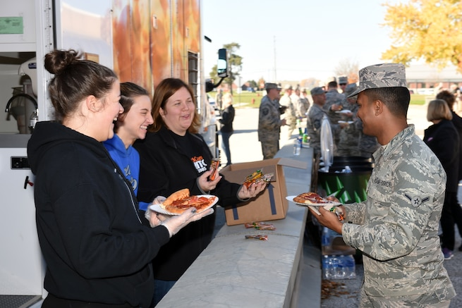 161106-Z-EZ686-043 -- Volunteers of Little Caesars mobile pizza kitchen serve pizza to military personnel at Selfridge Air National Guard Base, Mich. on Nov. 6, 2016. Michigan-based Little Caesars donated a total of 270 pizzas to the Selfridge family.  (U.S. Air National Guard photo by Master Sgt. David Kujawa)