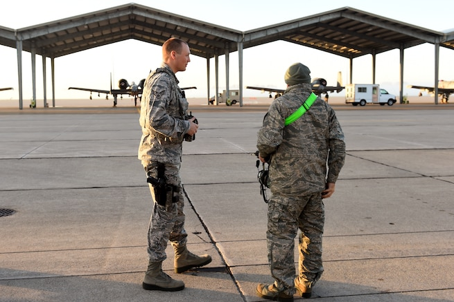 161106-Z-EZ686-028 -- Senior Airmen Scott Kultala of the 127th Security Forces Squadron conducts a flight line badge check for the maintenance personnel entering the flight line check point at Selfridge Air National Guard Base, Mich. on Nov. 6, 2016.  Routinely SFS conducts badge checks to ensure everyone entering has a current flight line badge. (U.S. Air National Guard photo by Master Sgt. David Kujawa)