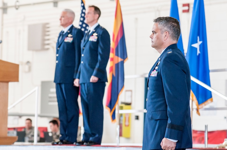 U.S. Col. Andrew J. MacDonald stands at attention as he waits to take command of the 162nd Wing, and promotion to the rank of brigadier general at a change of command ceremony in Tucson, Ariz., Nov. 5, 2016.  The 162nd Wing honors a military tradition dating back to the 18th Century that represents a format transfer of authority and responsibility for a unit from one commanding officer to another.  (U.S. Air National Guard photo by 1st Lt. Lacey Roberts)