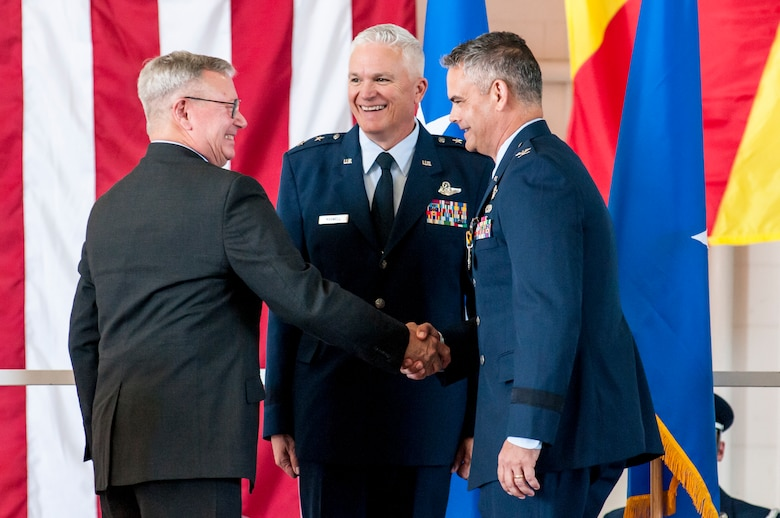 U.S. Army Retired Gen. Grass presents Brig. Gen. Andrew J. MacDonald, the newly appointed Commander of the 162nd Wing, with the Defense Superior Service Medal in Tucson, Ariz., Nov. 5, 2016. This medal was established by President Gerald R. Ford for those members in the armed forces performing commendable service in positions that hold great responsibility.  (U.S. Air National Guard photo by 1st Lt. Lacey Roberts)
