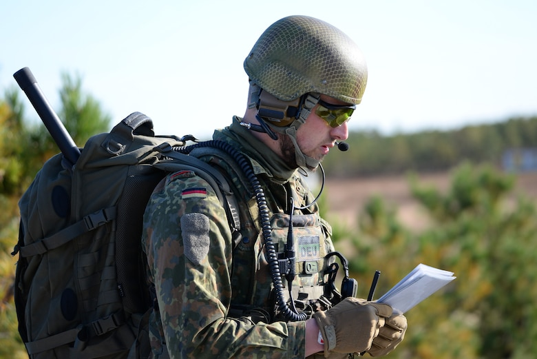 A picture of German armed forces Joint Terminal Attack Controller (JTAC) Capt. Tim Jantzen listening to a read back of nine line information.