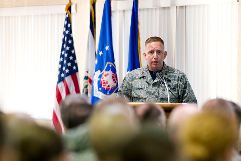Major Christopher Tusing, the 167th Airlift Wing's director of inspections, addresses the Air Mobility Command Inspector General and his inspection team during the Wing's capstone event in-brief Nov. 4. (U.S. Air National Guard photo by Senior Master Sgt. Emily Beightol-Deyerle)
