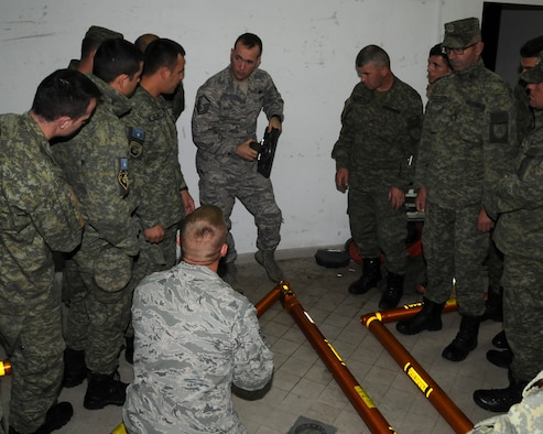 Mater Sgt. Ryan Baker and Technical Sgt. Alan Pick, Iowa National Guard's 185th Air Refueling Wing, instruct members of the Kosovo Security Forces Civil Protection unit on how to their new lightweight aluminum shoring equipment on October 21, 2016 at their base in Pomosoztin, Kosovo. Training on use of the equipment was provided by the Guardsmen during the Eagle V exercise which provides KSF the opportunity to train with the Iowa National Guard, NATO forces, U.S. Army Security Advisory Mentorship Training Organization and U.S. Army Europe in order to support the KSF mission of maintaining a safe and secure Kosovo. (U.S Air National Guard photo by Capt. Jeremy J. McClure)