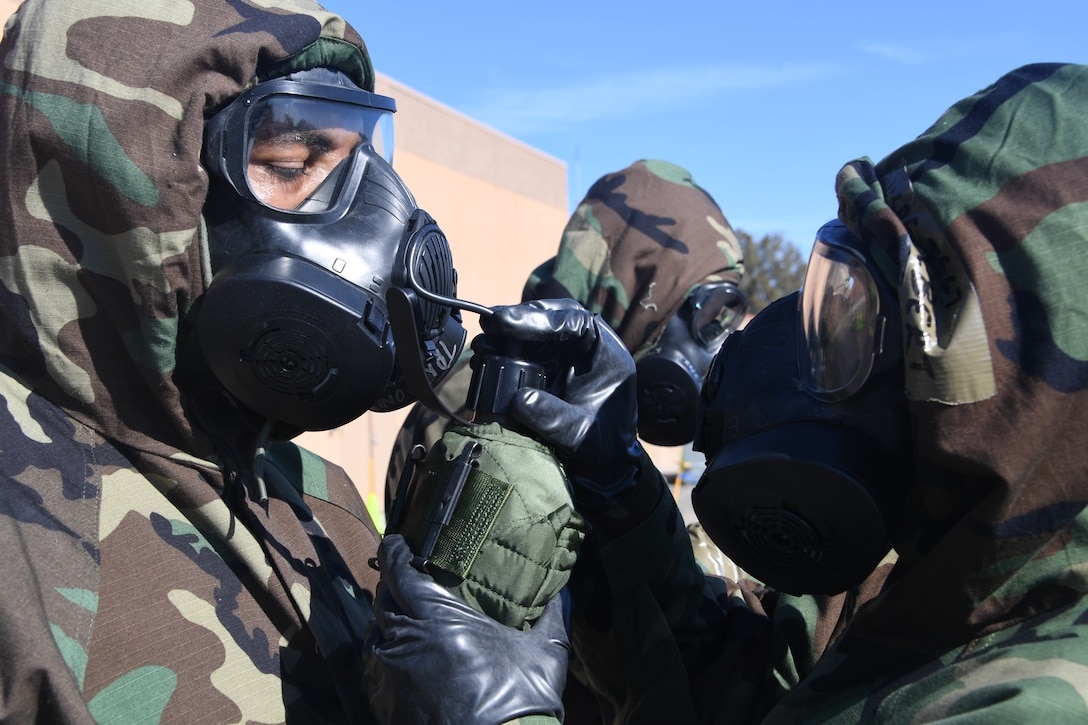 U.S. Air National Guardsmen at the 146th Airlift Wing participate in an Expeditionary Skills Rodeo on November 4, 2016. During the exercise participants practiced how to use the canteen will donning the gas mask. (U.S. Air National Guard photo by Senior Airman Madeleine Richards/Released)