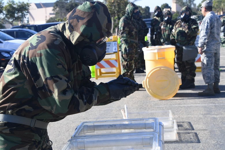 U.S. Air National Guardsmen at the 146th Airlift Wing participate in an Expeditionary Skills Rodeo on November 4, 2016. The decontamination is s station participants had to demonstrate skills for the wing inspection team.(U.S. Air National Guard photo by Senior Airman Madeleine Richards/Released)