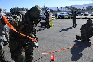 U.S. Air National Guardsmen at the 146th Airlift Wing participate in an Expeditionary Skills Rodeo on November 4, 2016. Participants cordon off unexploded ordnance (UXO) during inspection to demonstrate knowledge skills. (U.S. Air National Guard photo by Senior Airman Madeleine Richards/Released)