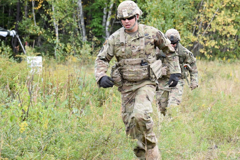 Sergeant Rayn Duginski and Staff Sergeant Wealey Goff of the 278th Armored Cavalry Regiment in Knoxville, Tenn., run towards the finishline during the land navigation and observation section of the Worthington Challenge.The Worthington Challenge is an internatoinal armored crew competition, hosted by the Canadian Army, focused on showing armed crew skills as well as sharing best training practices amongst allies.(US Air Force photo by Senior Airman Leon Bussey / Released)