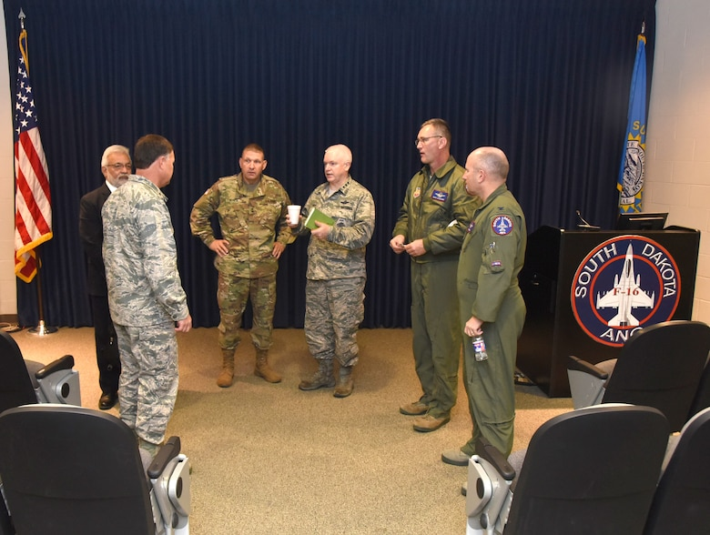 Lt. Gen. L. Scott Rice, Air National Guard Director, and Maj. Gen. Timothy Reisch, the Adjutant General, South Dakota National Guard, speak to senior leaders of the South Dakota Air National Guard, Nov. 5, 2016. Rice and Reisch toured base facilities and participated in a recognition ceremony during their visit to Joe Foss Field.