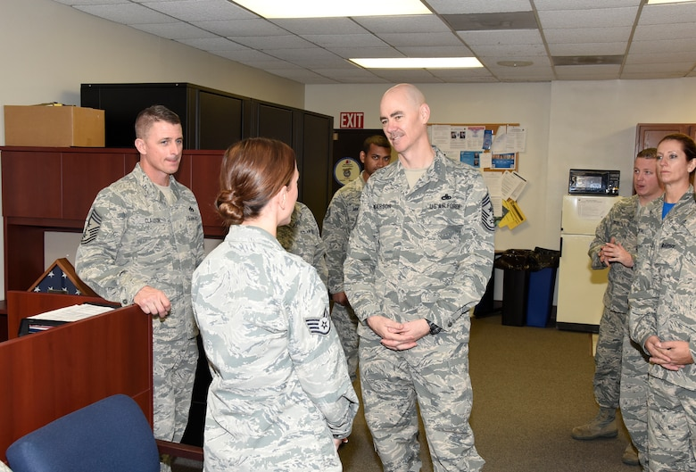 Chief Master Sgt. Ronald C. Anderson, Air National Guard command chief master sergeant, visits with Staff Sgt. Martina Dodge, Headquarters, South Dakota Air National Guard human resources personnel assistant, and other Airmen, Nov. 6, 2016.  As the highest level of enlisted leadership, Chief Anderson is responsible for matters influencing the health, morale, welfare and professional development of more than 105,400 Air Guard members.  (U.S. Air National Guard Photo by Master Sgt. Chris Stewart /Released)