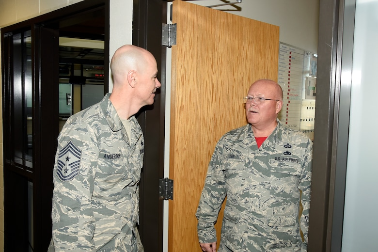 Chief Master Sgt. Ronald C. Anderson, Air National Guard command chief master sergeant, visits with Chief Master Sgt. Bruce Lee, 114th Fighter Wing Operations Support Squadron superintendent, during his visit to Joe Foss Field, S.D., Nov. 6, 2016.  As the highest level of enlisted leadership, Chief Anderson is responsible for matters influencing the health, morale, welfare and professional development of more than 105,400 Air Guard members.  (U.S. Air National Guard Photo by Master Sgt. Chris Stewart /Released)