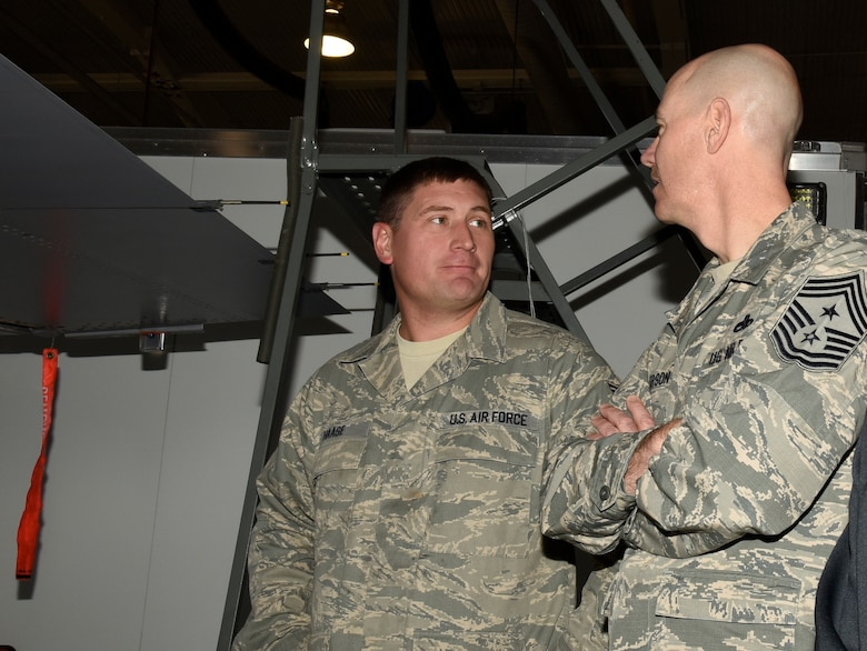 Chief Master Sgt. Ronald C. Anderson, Air National Guard command chief master sergeant, visits with Technical Sgt. Ryan Haase, 114th Maintenance Squadron fuel systems mechanic, during his visit to Joe Foss Field, Nov. 6, 2016.  As the highest level of enlisted leadership, Chief Anderson is responsible for matters influencing the health, morale, welfare and professional development of more than 105,400 Air Guard members.  (U.S. Air National Guard Photo by Master Sgt. Chris Stewart /Released)