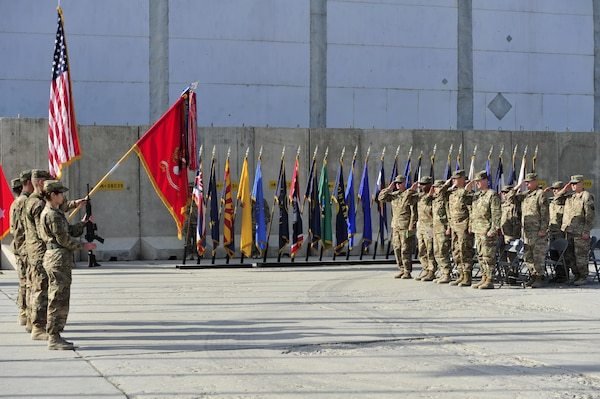 BAGRAM AIRFIELD, AFGHANISTAN (Nov. 2, 2016) - The color guard, dignitaries, and guests render honors to the flag during the national anthem at the transfer of authority ceremony from 2nd Battalion, 44th Air Defense Artillery Regiment to the 5th Battalion, 5th Air Defense Artillery Regiment.  The ADA battalion provides counter rocket, artillery, and mortar protection to Bagram Airfield.  Photo by Bob Harrison, U.S. Forces Afghanistan Public Affairs.
