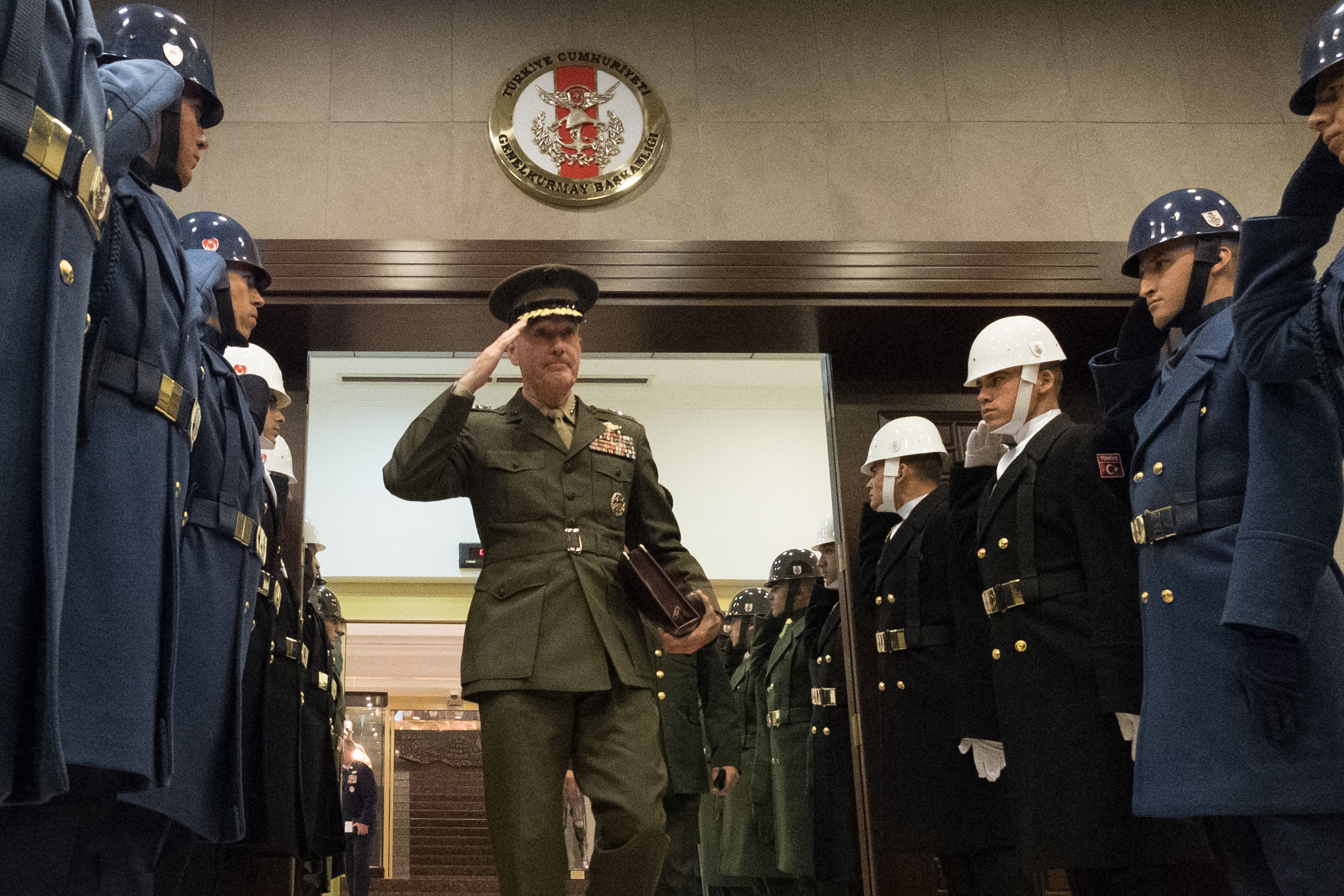 Marine Corps Gen. Joe Dunford, chairman of the Joint Chiefs of Staff, salutes Turkish honor guard members.