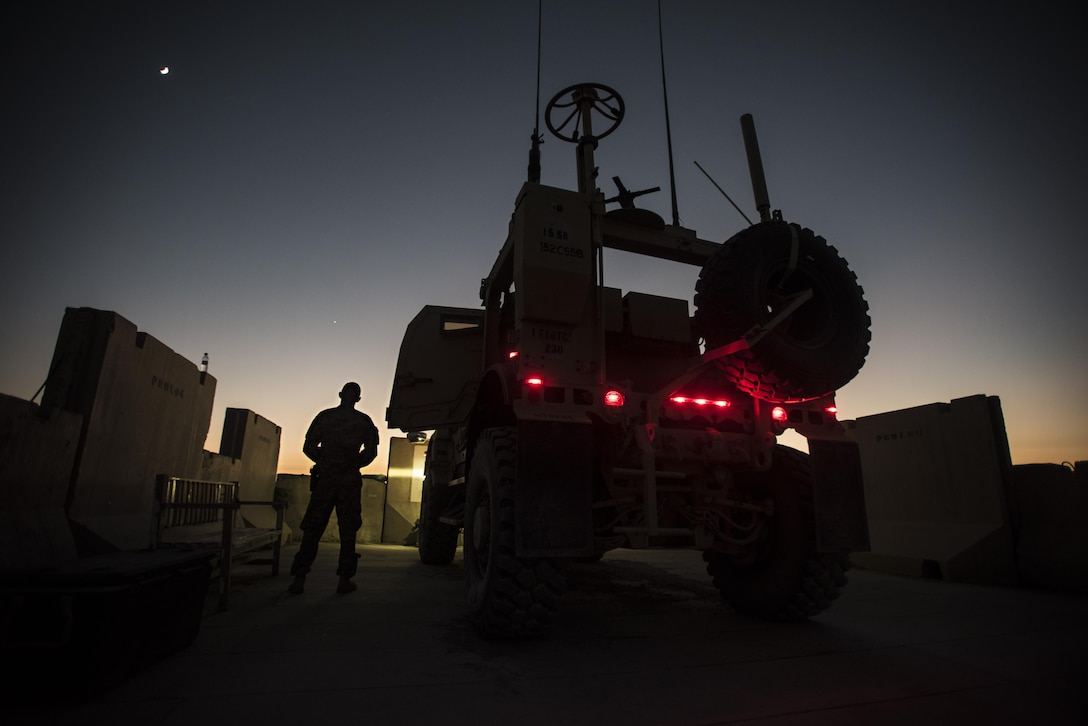 Senior Airman Tyler Phillips, 451st Expeditionary Support Squadron response force member, monitors his team's security sector at Kandahar Airfield, Afghanistan Nov. 5, 2016. Response force teams are posted around the airfield at Kandahar to ensure 360-degree security. (U.S. Air Force photo by Staff Sgt. Katherine Spessa)