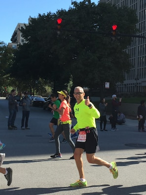 Senior Master Sgt. Todd Kirkwood, 167th avionics superintendent, gives a thumbs up at mile 25 of the Chicago Marathon, Oct. 9, 2016. Kirkwood ran the marathon only eight months after undergoing chemotherapy and radiation treatments for cancer.