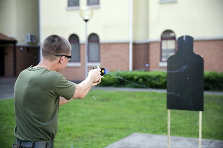 Lance Cpl. Ty Underwood, a cyber-network specialist with Special Purpose Marine Air-Ground Task Force Crisis Response-Africa, fires the X26 Taser at a target during non-lethal training at Naval Air Station Sigonella, Italy, Nov. 1, 2016. Marines completed a weeklong non-lethal course, which covered Taser training, OC exposure and riot control team tactics.  (U.S. Marine Corps photo by Cpl. Alexander Mitchell/released)