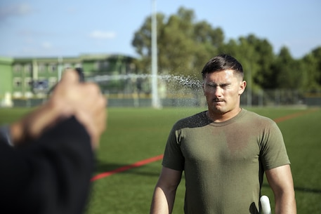 Cpl. Tyler Boyd, a rifleman with Special Purpose Marine Air-Ground Task Force Crisis Response-Africa, is sprayed with OC spray during non-lethal training at Naval Air Station Sigonella, Italy, Nov. 2, 2016. Marines completed a weeklong non-lethal course, which covered Taser training, OC exposure and riot control team tactics.  (U.S. Marine Corps photo by Cpl. Alexander Mitchell/released)