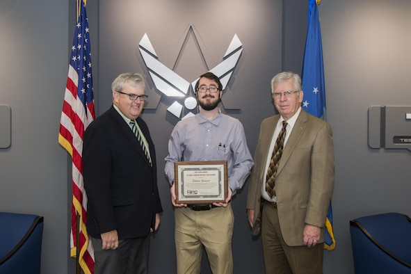 AEDC Scientist and Engineer Stephen Guimond (center) accepts the 2016 Hero Award for the Up and Coming within the Department of Defense High Performance Computing Modernization Program, or HPCMP, from Dr. Kevin Newmeyer (left), chief of staff of the DOD HPCMP, Oct. 17, 2016. Accompanying Guimond is the Air Force Test Center, AEDC Chief Technologist Dr. Edward Kraft. (U.S. Air Force photo/Jacqueline Cowan)