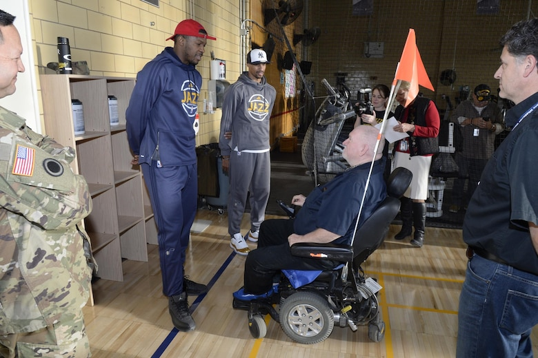 Utah Jazz players Derrick Favors and George Hill visit with a veteran at the newly remodeled gymnasium at the George E. Whalen Veterans Affairs Medical Center in Salt Lake City during the annual NBA/Department of Defemnse service project called 'Commitment to Service,' Thursday, Nov. 3, 2016. (U.S. Air Force photo by Todd Cromar)