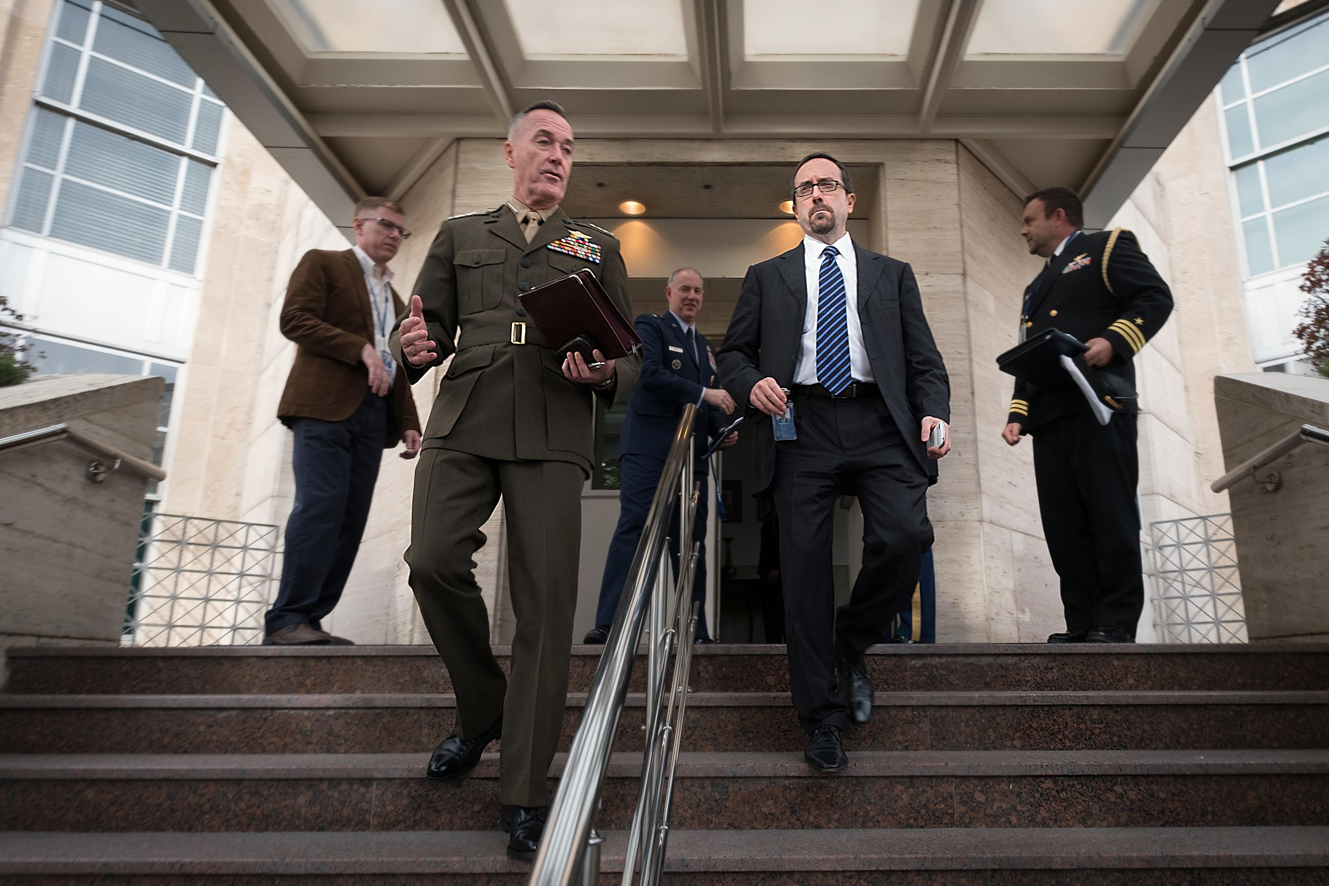 Marine Corps Gen. Joe Dunford, chairman of the Joint Chiefs of Staff, and U.S. Ambassador to Turkey John R. Bass head to a meeting.