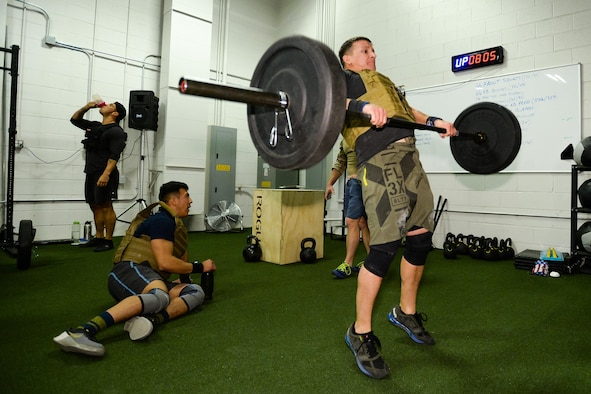 Tech. Sgt. Timothy Lincoln, 775th Explosive Ordnance Disposal Flight, performs a 135-pound hang clean during the EOD 131 Memorial Workout at Hill Air Force Base, Nov. 4, 2016. (U.S. Air Force photo by R. Nial Bradshaw)