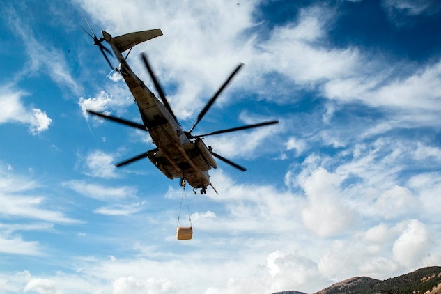 A CH-53E Super Stallion, with Marine Heavy Helicopter Squadron 466, transports a 500-gallon drum of water to Marines who are conducting field operations in the Sierra Mesa Mountains, Calif., Oct. 25, 2016. The drum supported Marines who participating during Mountain Exercise 6-16. (U.S. Marine Corps photo by Lance Cpl. Adam Dublinske)