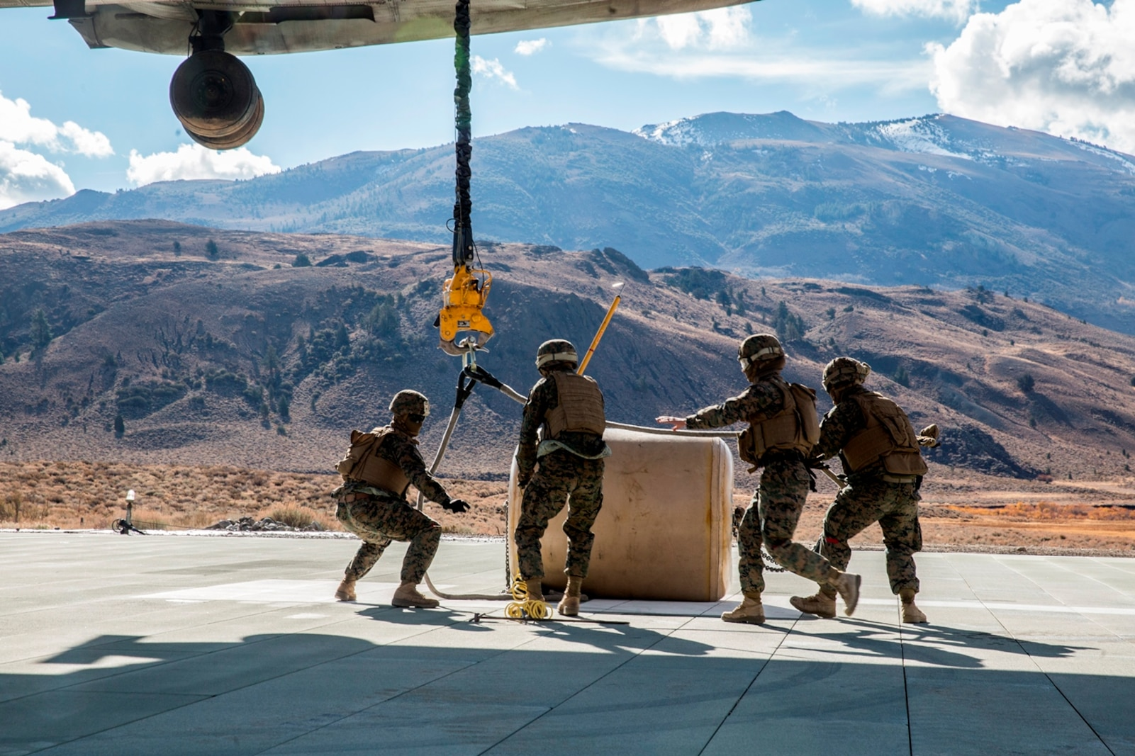 U.S. Marines with Combat Logistics Battalion 15, 1st Marine Logistics Group, and 3rd Battalion, 4th Marine Regiment, 1st Marine Division, strap a 500-gallon drum of water to a CH-53E Super Stallion, with Marine Heavy Helicopter Squadron 466, during a Helicopter Support Team drill at Mountain Warfare Training Center, Bridgeport, Calif., Oct. 25, 2016. The drum was taken into the Sierra Mesa Mountains to support Marines who are conducting field operations during Mountain Exercise 6-16. (U.S. Marine Corps photo by Lance Cpl. Adam Dublinske)