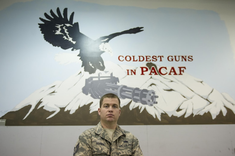 U.S. Air Force Tech. Sgt. Ben Hardy, the 354th Maintenance Squadron armament maintenance noncommissioned officer in charge, takes a brief break Nov. 3, 2016, at Eielson Air Force Base, Alaska. Hardy said the extended hours of darkness is one of his favorite parts of Alaska. (U.S. Air Force photo by Airman Isaac Johnson)