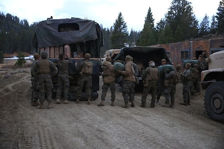 U.S. Marines with Combat Logistics Battalion 15, 1st Marine Logistics Group, unload Meals Ready to Eat from the back of a Medium Tactical Vehicle Replacement in Mountain Warfare Training Center, Bridgeport, Calif., Oct. 22, 2016. CLB-15 resupplied Marines from 3rd Battalion, 4th Marine Regiment, 1st Marine Division, with 1,900 gallons of water and seven pallets of Meals Ready to Eat during the mountain exercise. (U.S. Marine Corps photo by Lance Cpl. Austin Mealy)
