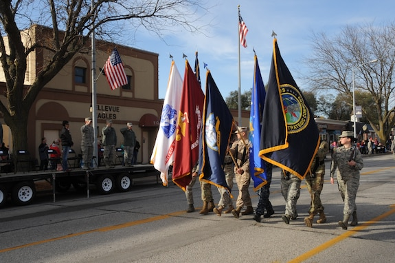Members of U.S. Strategic Command's (USSTRATCOM) Joint Color Guard march in the 2016 Veteran's Day Parade in Bellevue, Neb., Nov. 5, 2016. Senior leaders from USSTRATCOM and the 55th Wing also attended the seventeenth annual parade to support the service members from their respective commands who volunteered to participate and honor U.S. veterans, both past and present.