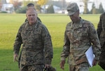 Army Brig. Gen. Charles Hamilton, DLA Troop Support commander (right), greets Gen. Robert B. Neller, commandant of the Marine Corps, as he arrives for a visit to DLA Troop Support in Philadelphia Nov. 2