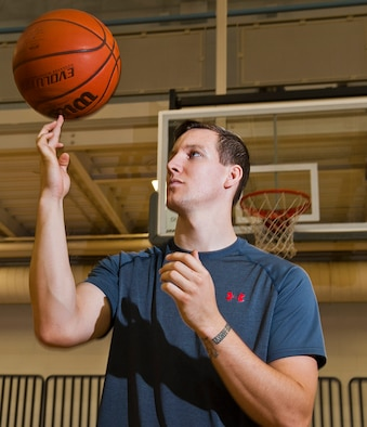 Airman 1st Class Cody Sluder, 791st Missile Security Forces Squadron member, spins a basketball on his finger at Minot Air Force Base, N.D., Oct. 15, 2016. Sluder was one of 27 Airmen selected to attend the 2016 All-Air Force men's basketball team trial camp at Joint Base San Antonio-Lackland, Texas. (U.S. Air Force photo/Airman 1st Class Jonathan McElderry)