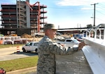 """Defense Logistics Agency Aviation Commander Air Force Brig. Gen. Allan Day signs the final structural beam that will be placed on Phase I of the new DLA Aviation Operations Center at Defense Supply Center Richmond, Virginia, in a """"topping off"""" ceremony held on the construction site Nov. 3, 2016. The beam will go in one of the elevator shafts and finalizes the framing of the building. The Phase I building should be completed and ready for occupancy by DLA Aviation employees between December 2017 and January 2018."""