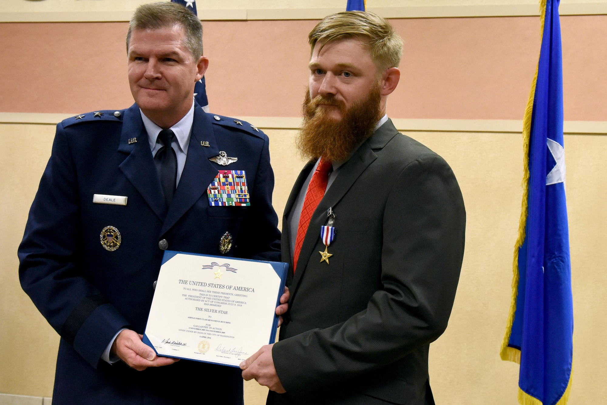Maj. Gen. Thomas Deale, Air Combat Command director of operations, presents retired Staff Sgt. Benjamin Hutchins, 18th Air Support Operations Group joint terminal attack controller, with the Silver Star Medal during a ceremony, Nov. 4, 2016 at Pope Army Airfield, North Carolina. Hutchins received the medal for his heroic actions during a deployment while assigned to the 504th Expeditionary Air Support Operations Group in Bala Murghab, Afghanistan in 2009. (U.S. Air Force photo by Airman Miranda A. Loera)